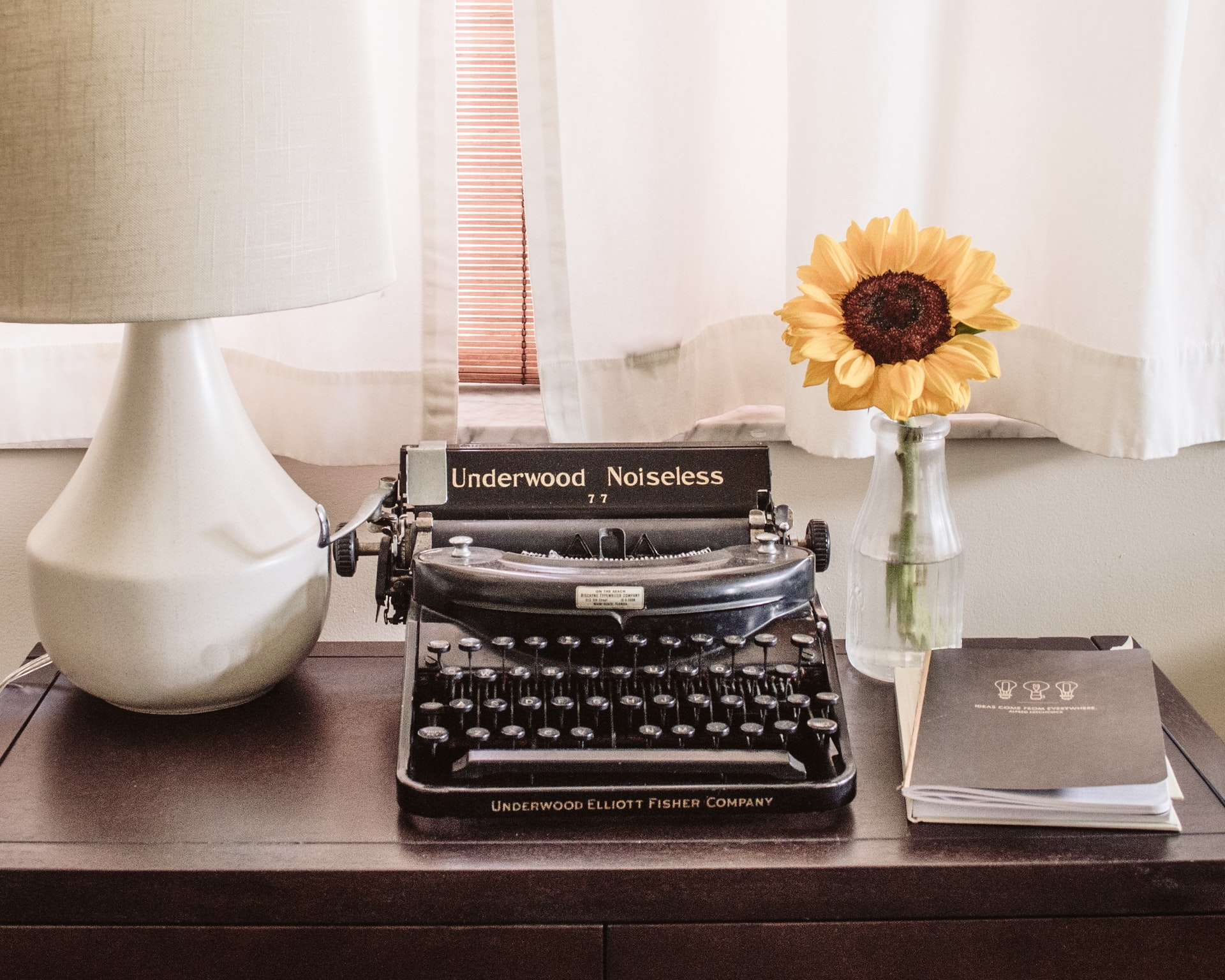 Picture of a typewriter and sunflower as used by an editor